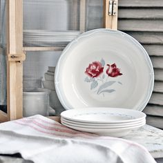 A vintage French Digoin serving bowl with a pretty red rose and tulip pattern