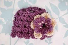 Red Heart soft yarn really makes these flowers look real. Crochet flower patterns are the best as you can keep them around all year long without the hassle. Like its title, they're always in bloom.