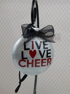 Personalized Cheerleading Glass Ornament..Customized to match your team colors Ornament is a 3 M&M shaped glass ornament that is hand glittered and