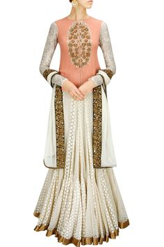 CLASSIC CONTRASTS : Peach sequin flower jacket with ivory kalidaar skirt and dupatta by Joy Mitra.