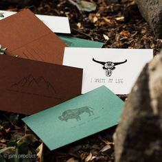 """""""My dearest, I write you from the most exciting journey I've taken to see the WORLD. I walked through the mountains, I saw the bisons and I flew with the eagles. I will never come back home. Love, Your Nature.""""  View and order on www.jsmproduct.com or Facebook/ Instagram: Jsm Product  #handmade #notebook #handmadenotebook #nature #recycled #wood #bison #mountains #scull #wether #sheep #horn #eagle #sewing #czechrepublic #jsmproduct #postcard Handmade Notebook, Nature View, Recycled Wood, Bison, Facebook Instagram, Eagles, Horns, Sheep, Studios"""