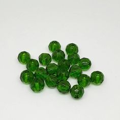 6mm emerald green faceted fire polished glass round beads.  Quantity: 20  Please note that the colors in the images may differ slightly due to variations in computer resolution.  *** SHIPPING *** Your purchase will ship within one to two business days upon receiving payment. #etsy #craft #crating #crafts #jewelry #making #supplies #jewelrymaking #jewelrysupplies #diy #easy #doityourself #shop #beads #rondelle #glass #beads #firepolished #fire #polished #emerald #green #christmas