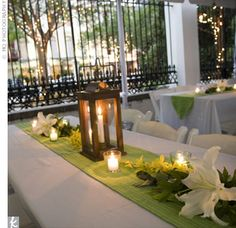 Lanterns with green runners and votives