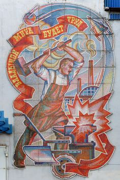 CCCP. Mosaic at the facade of the Dormash (road machines) plant in Vologda, a city and the administrative, cultural, and scientific center of Vologda Oblast, Russia, located on the Vologda River within the watershed of the Northern Dvina.