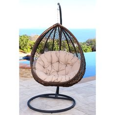 Make your outdoor sitting area more comfortable and stylish with this Abbyson Living wicker swing chair, a breezy and attractive piece that your guests are sure to love. A soft beige cushion lets you sink back in comfort.