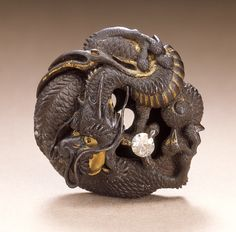 Mitsukiyo (Japan)   Dragon Guarding the Jewel of the Buddha, 19th century  Netsuke, Iron, gilt, diamond,
