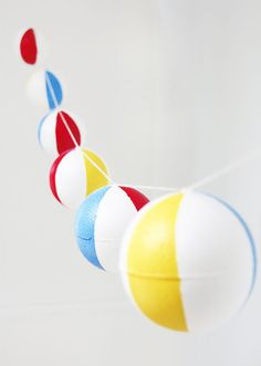 DIY this colorful banner using Smoothfoam balls + craft paint for an easy way to make your space next-level.