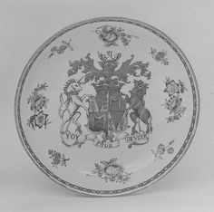 "This is a porcelain saucer that was made in China. It dates to c. 1750 AD. Though being Chinese in origin, it shows the phrase, ""Foy Pour Devoir"" meaning, ""Faith for Duty"". This was the catchphrase of Archibald Seymour, 13th Duke of Somerset. Because of this, I believe that this saucer was imported to England."