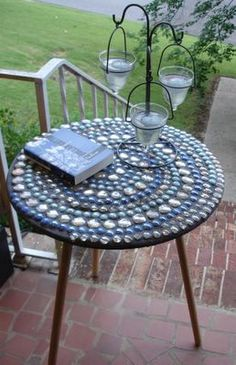 Mosaic table made of glass pebbles  give an old table a new lease of life!