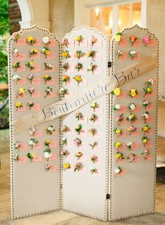 flower keepsake escort cards—   http://www.stylemepretty.com/2014/06/12/whimsical-maryland-wedding-at-woodend-sanctuary/
