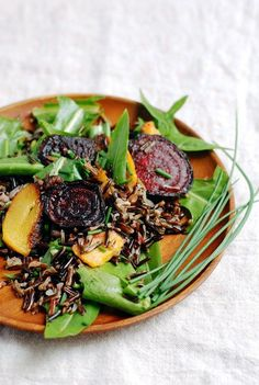This Wild Rice Salad with Roasted Beets and Rutabagas, and Dandelion Greens is great as a hearty side dish, but is also perfect for a light #dinner or #lunch.