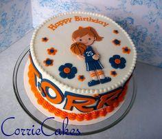 Basketball cake eccept the little girl doesen't look like Asia