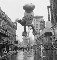 Circa 1962, Times Square, Manhattan, NY:  Macy's Parade. Times Square & 43rd Street. All He's Quacked Up To Be, Donald Duck takes a bow in Times Square. — Image by © Bettmann/CORBIS