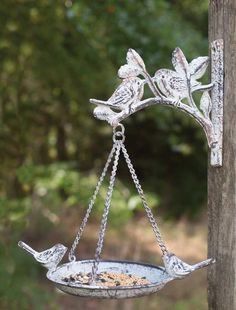 Description Sturdy Cast Iron Bird Feeder/Bird Bath Bracket included measures x x Hanging hardware included Pan measures 6 (without birds) x Bird Seed Feeders, Hanging Bird Feeders, Hanging Plants, Bird Cages, Birds For Sale, Leaf Man, Bird House Kits, How To Attract Birds, Bird On Branch