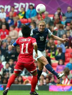 Rachel Buehler of USA heads past Kim Chung Sim of DPR Korea during women's soccer first round group G match on day 4