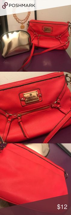 Nicole Miller crossbody bonus makeup bag Nicole Miller crossbody purse  red with a hint of orange. Super cute color. Gold chain, gold Nicole Miller signature label  measure 11wx8h  used but great condition, inside is completely clean.. included is a brand new gold makeup bag purchased from jcpenneys Nicole Miller Bags Crossbody Bags