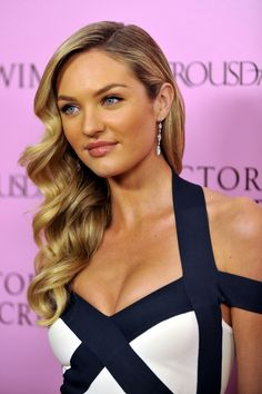 Candice posed for cameras as she showed off her retro inspired waves. Her long locks