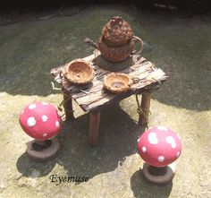acorn teapot and acorn cap plates with mushroom stools for the table