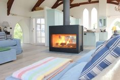 Kernow Fires Stuv 21 125 double sided bespoke fire wood burning stove installation in Cornwall.