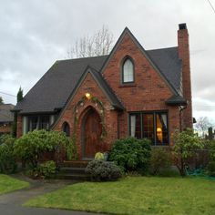 Brick Tudor with Pointed Arched Doorway | NWYardandHome.com
