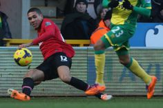 Chris Smalling whips a ball in