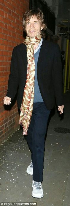 Sir Mick Jagger pictured leaving Tuesday's concert. He took seat at her London show