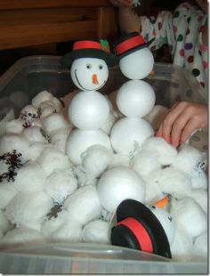 """http://homeschooladventures3.blogspot.com/2011/01/january-sensory-tub-build-snowmen.html """"Sensory Tub Ideas: It's not very complicated.  All it contains is a large piece of polystyrene at the bottom of the tub, a lot of cotton balls, 3 snowmen heads, different-sized polystyrene balls with toothpicks, and snowflake confetti (black on one side, white on the other)."""""""