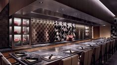 Teppanyaki grill hemmed in by a black-and-white stone counter with place settings Tokyo Hotels, Hotel Packages, Teppanyaki, Tokyo Tower, Romantic Getaways, Ceiling Windows, White Stone, Place Settings, Hotels And Resorts