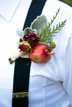 A pomegranate boutonnière? That's really sexy.