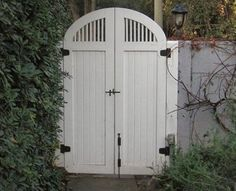 A photo of a Cottage style curved wooden garden gate I custom designed and built in Los Angeles. Serving the West Los Angeles communities of Hancock Park, Bel Air, Brentwood, Westwood and more. Backyard Gates, Driveway Gate, Backyard Pergola, Fence Gate, Metal Pergola, Patio, Side Gates, Front Gates, Entrance Gates