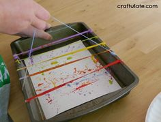 Painting with Rubber Bands - fun process art for kids!