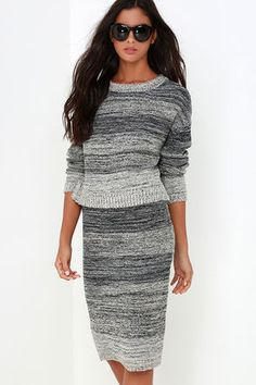 """We're sure that the Nook and Corner Grey Marl Two-Piece Sweater Dress is the cutest way to stay warm! Black, grey, and beige knit forms cute, sweater with ribbed detailing along the rounded neckline, long sleeve cuffs, and notched hem. Matching pencil skirt has similar ribbed detailing at the waist and midi-length hem. Unlined. Small top measures 19.5"""" long. Small bottom measures 26"""" long. 60% Acrylic, 31% Polyester, 9% Wool. Hand Wash Cold or Dry Clean. Imported."""