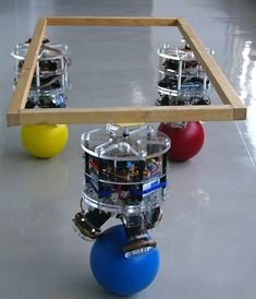 Robot that balances on a ball: In japan, a robot is being developed that can balance on a ball. I love japan.