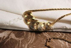 Ribbon Curl Gold tone necklace 1989 Vintage Avon by FrogTears on Etsy