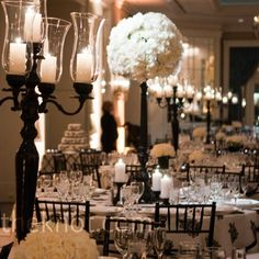 All-white floral arrangements and black candelabras achieved the dramatic look the couple wanted.