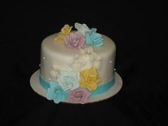 Birthday cake for her designed to match the top tier of their wedding cake with hand crafted sugar roses