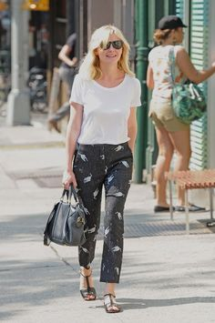 Kirsten Dunst was spotted wearing Miu Miu RTW Spring 2010 Cat Print Pants  while out and about. 3539bd968c8