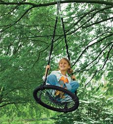 Round-and-Round Outdoor Swing brings your kid's favorite playground activity home.