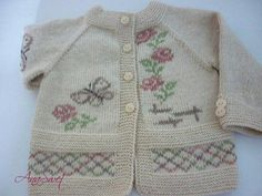 Hand knit baby cardigan with flowers and butterflies.Baby