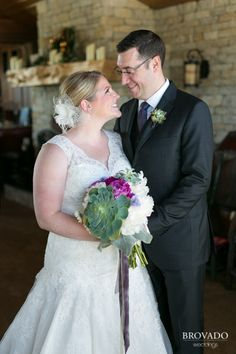 Beautiful photo of the bride and groom. And an AWESOME succulent wedding bouquet!