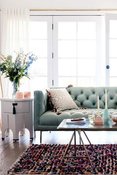 Archway End Table with light blue tufted sofa. love this mix of boho and mid century modern classic home decor for the living room