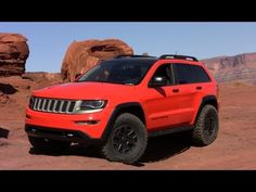 ( http://www.TFLcar.com ) Four standout features stand out on the Jeep Grand Cherokee Trailhawk II concept. This baby comes with the outstanding 3.0-liter, turbodiesel V6 that makes 420 lbs-feet of torque hooked up to an eight-speed automatic transmission.  Mopar tow hooks, rock rails, skid plates and beefy 35-inch Micky Thompsons mounted to Mop...