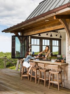 This Rhode Island home on Block Island has stunning views and an indoor-outdoor kitchen/bar #hgtvmagazine http://www.hgtv.com/design/decorating/design-101/a-rhode-island-home-thats-made-for-visitors-pictures?soc=pinterest