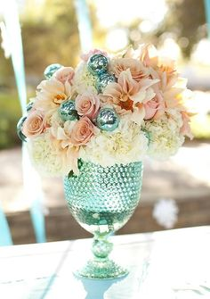 A centerpiece of flowers and a nice vase can bring a lot of life into a room!
