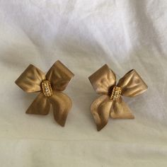Vintage Gold Bow Stud Earrings Gently loved condition. 😺 Comes from a smoke-free, but not pet-free home. ➡️ Offers welcomed. 🚫 No trades. No holds. 📦 Fast shipping! 👰🏻 Saving up for my wedding, so considering all reasonable offers! Jewelry Earrings
