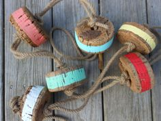 $48.00-(75''TWINE ROPE & (6) CORK 4''ACROSS BOUYS / HAND PAINTED) **************************************************************** Nautical Buoys. Vintage. Cork. Nautical Decor. by searchnrescue2