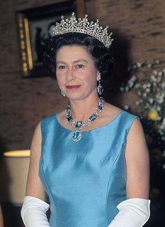 queen Elizabeth II in blue and Girls of Great Britain tiara