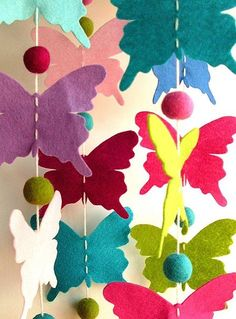 Butterflies: would like to make this to hang around my daughters ceiling light in her bedroom, would make it so much prettier.