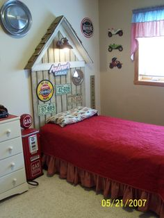 Garage Themed Boys Room, We redid this room when our son was two and still in a toddler bed. We built the garage-themed headboard to work with the twin bed that hell be moving into soon. He loves cars. We wanted to do something different than just cars so my husband built a headboard to look like an old-time garage. It was built to have a working light above the bed and extra material was used to create a matching shelf. --------- UPDATE: A new photo was added showing our sons new twin…