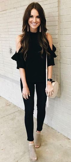 All black trendy cold shoulder top and skinny jeans.